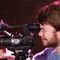 videographer using tripod