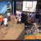 A picture in a picture, the larger is of African orphans playing basketball, the smaller is of a pro basketball game