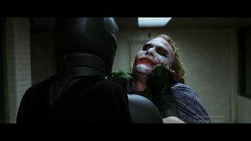 scene from the dark knight where batman interrogates the joker