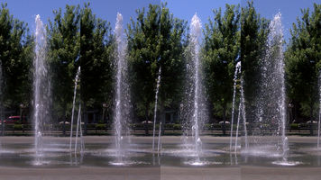 four still shots of the same fountain shot with various shutter speeds
