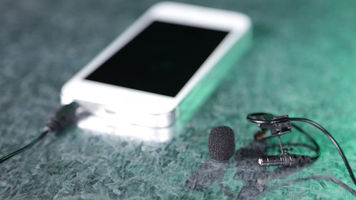 iphone with the RØDE SmartLav and windscreen beside it