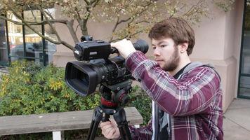 camera operator tilting the camera diagonally for a dutch angle